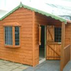 15 14x14 Tongue and Groove shed with recessed porch and bay window